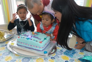 Jetsun Yudra enjoys her 2nd birthday celebration with the Sakyong, the Sakyong Wangmo and Jetsun Drukmo. Photo by Ian Bascetta