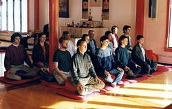 Shrine room full of meditators doing a dathun