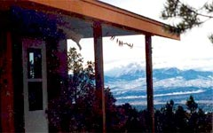Photot of sky and mountains form porch of  retreat building at Dorje Khung Dzong
