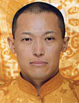 photo of Sakyong Mipham Rinpoche in yellow brocade with yellow background