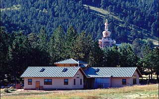 Photo of Shambhala Mountian center's Stupa of Dharmalkaya with Sacreds studies hall in foreground