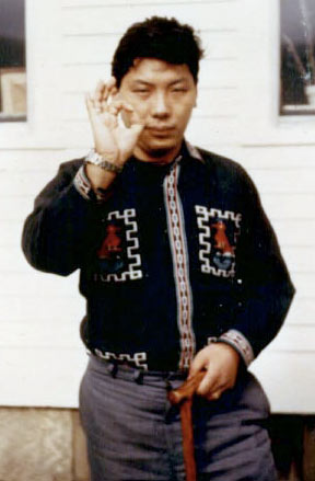 Photo of Chogyam Trungpa during his early  years in North America in a western shirt and holding his right hand in a mudra