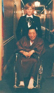 Chögyam Trungpa Rinpoche in wheelchair with Kasung